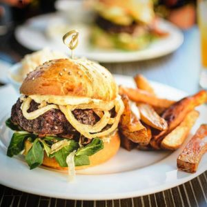 The restaurant will carry classic American food like burgers and fries as well as Tex-Mex favorites and gyros.