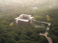 Xiangmi Science Library connected to park by glazed walkway through tr...