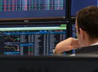 Stocks tumble amid earnings, trade uncertainty