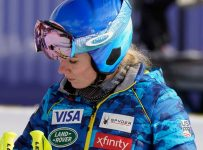 United States' Mikaela Shiffrin stands in the finish area after inspecting the women's super-G course, at the alpine ski World Championships in Cortina d'Ampezzo, Italy, Tuesday, Feb. 9, 2021. (AP Photo/Giovanni Auletta)