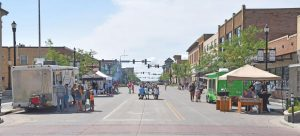Downtown Williston gets Crazy with sidewalk sales, food and entertainm...